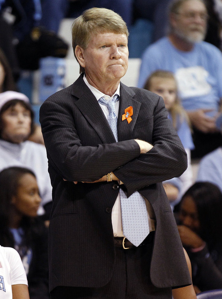 Photo - North Carolina associate head coach Andrew Calder reacts during the second half of an NCAA college basketball game against Maryland, Sunday, Jan. 5, 2014, in Chapel Hill, N.C. Maryland won the game 79-70. (AP Photo/Ellen Ozier)