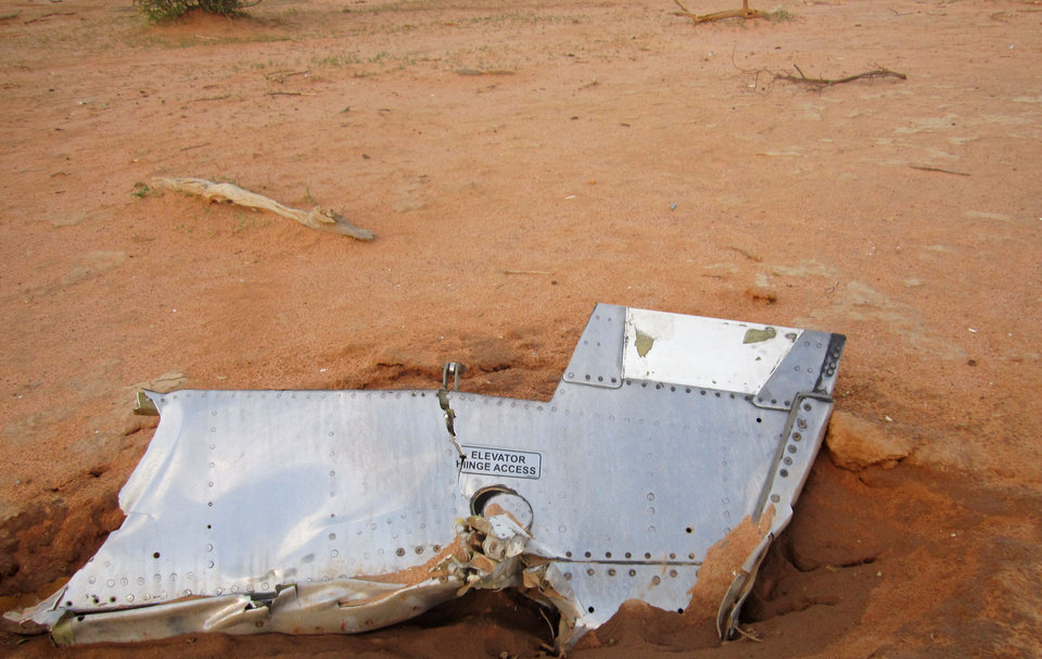 Photo - This photo provided on Friday, July 25, 2014,  by the Burkina Faso Military shows a part of the plane at the crash site,  in Mali. French soldiers secured a black box from the Air Algerie wreckage site in a desolate region of restive northern Mali on Friday, the French president said. Terrorism hasn't been ruled out as a cause, although officials say the most likely reason for the catastrophe that killed all onboard is bad weather. At least 116 people were killed in Thursday's disaster, nearly half of whom were French. (AP Photo/Burkina Faso Military)