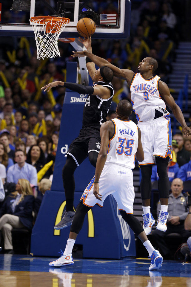 Thunder's Serge Ibaka (9) tries to block a shot by Brooklyn's Paul Pierce in the first half of an NBA basketball game where the Oklahoma City Thunder were defeated 95-93 by the Brooklyn Nets at the Chesapeake Energy Arena in Oklahoma City, on Thursday, Jan. 2, 2014. Photo by Steve Sisney The Oklahoman