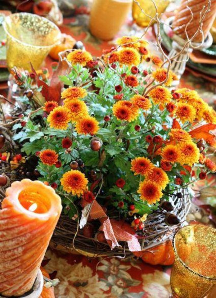Photo - Mums are the quintessential fall bloom, and nothing says Thanksgiving more than a beautiful centerpiece featuring the fiery orange and red hues of the beautiful flowers. This centerpiece was pinned by Carmen Castellvi. Photo provided.