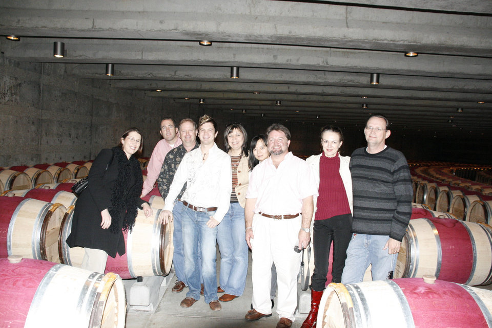 """From left to right, Redlands Community College students, Sonya Kappus, Bret Kappus, Bob Stobaugh, Doug Stobaugh, Karen Stobaugh, Katy Snyder, viticulture and enology instructor Andrew Snyder, Elana and Dale Pound pose in the Opus One barrel room.  The students attended the American Society of Enology and Viticulture """"United Symposium"""" in Sacramento last week.<br/><b>Community Photo By:</b> photo provided<br/><b>Submitted By:</b> andrew, Calumet"""