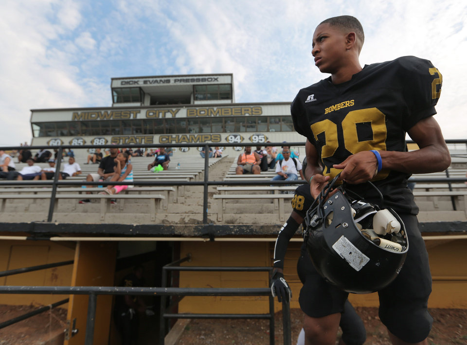 Jonathan Johnson, a sophomore, walks out the locker room to play with the junior varsity team during a scrimmage between Midwest City and Carl Albert at Bomber Stadium in Midwest City, Thursday, Aug. 23, 2012.  Photo by Garett Fisbeck, For The Oklahoman