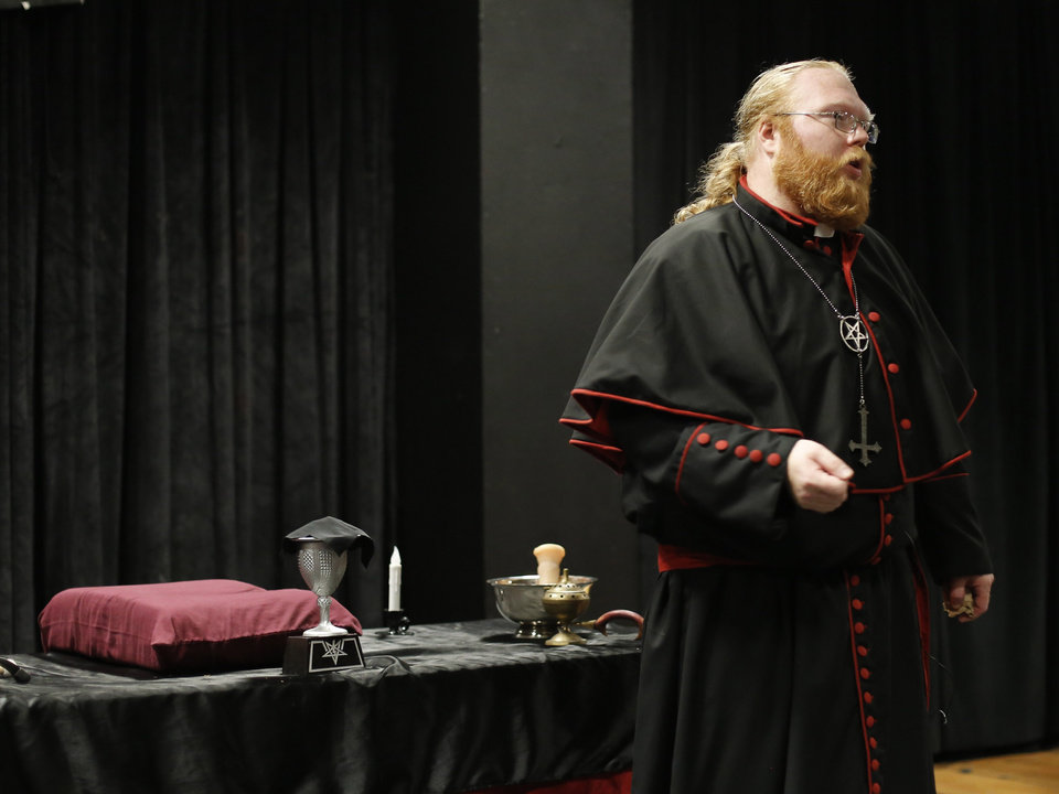 "Photo - Satanist Adam Daniels shares information about the history of the ""black mass"" and Satanism during his black mass event at the Civic Center on Sunday, Sept. 21, 2014. Photo by Doug Hoke, The Oklahoman"
