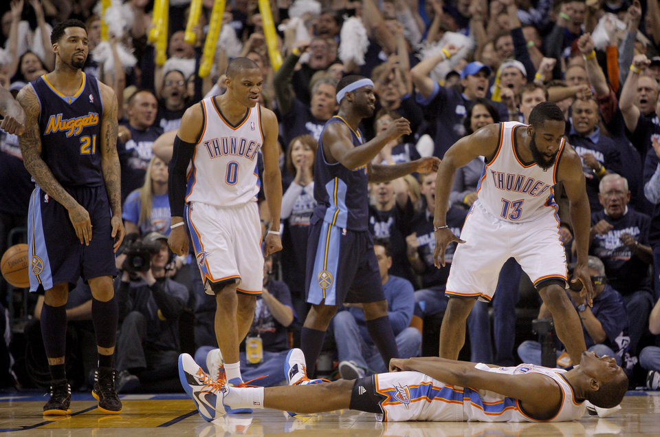 Photo - Oklahoma City's Russell Westbrook (0), Kevin Durant (35), and  James Harden (13) celebrate after Durant was fouled while making a basket during the NBA basketball game between the Denver Nuggets and the Oklahoma City Thunder in the first round of the NBA playoffs at the Oklahoma City Arena, Wednesday, April 27, 2011. Photo by Bryan Terry, The Oklahoman