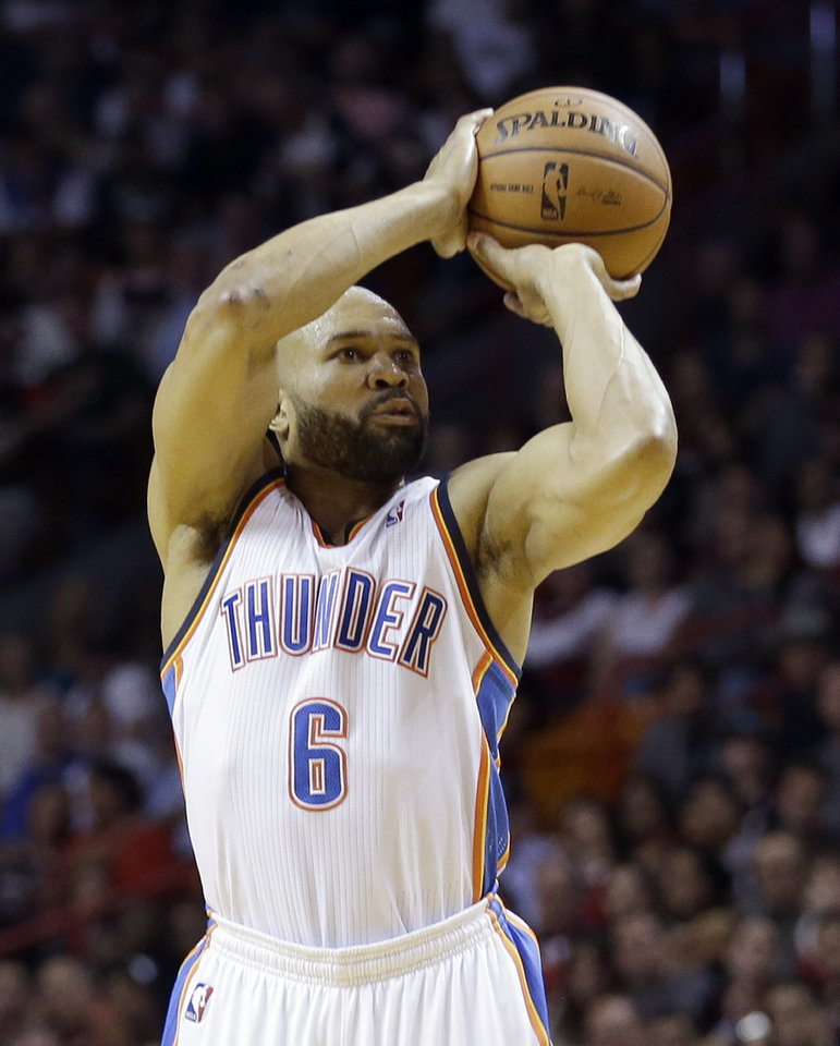 Photo - Oklahoma City Thunder point guard Derek Fisher (6) shoots a 3-pointer against the Miami Heat during the fourth quarter of an NBA basketball game in Miami, Wednesday, Jan. 29, 2014. The Thunder won 112-95.  (AP PhotoAlan Diaz)
