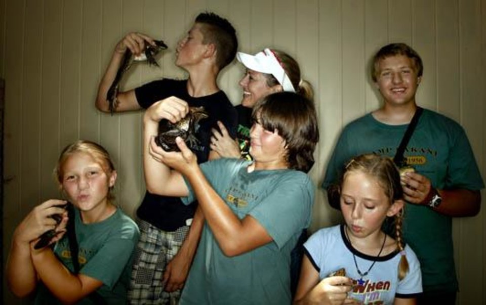 Photo -  Pictured Wednesday, June 24, 2009, at  Camp DaKaNi in Oklahoma City. are:  front left to right Kylie Moates, 9, Colby Moates, 12, and Lauren Cochell, 7. Back left to right Jake Prior, 15, Lisa Cochell and Derek Moates. Photo by Sarah Phipps, The Oklahoman