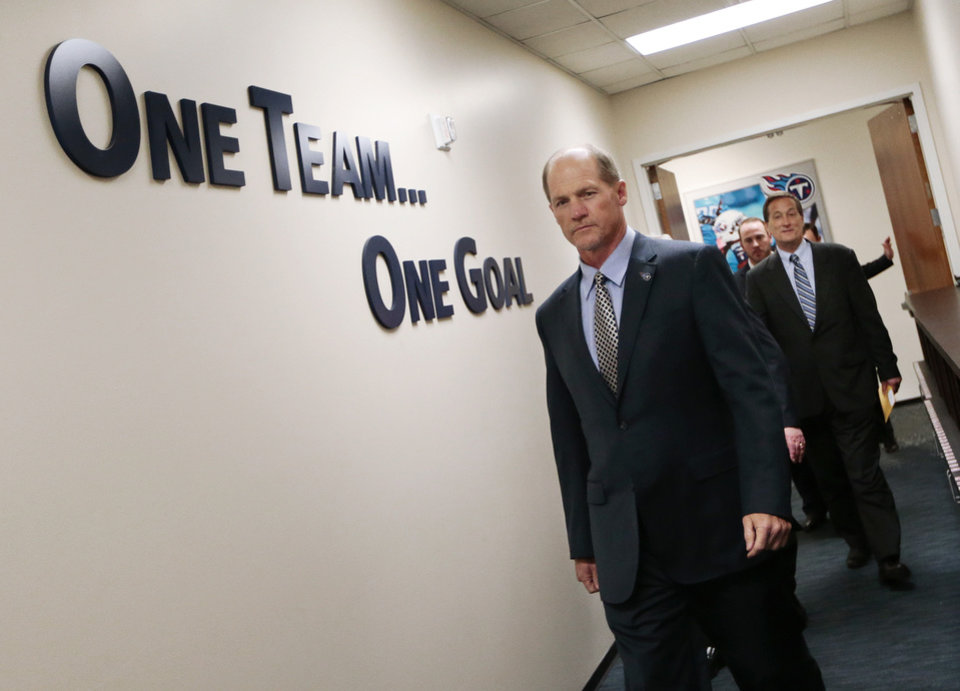 Photo - Tennessee Titans coach Ken Whisenhunt arrives for a news conference Tuesday, Jan. 14, 2014, in Nashville, Tenn. The Titans introduced Whisenhunt as their 17th head coach and only their third different coach since moving from Houston to Tennessee. At right is Titans executive vice president Don MacLachlan. (AP Photo/Mark Humphrey)