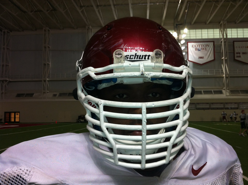 Oklahoma's Jamarkus McFarland shows off his facemask. Photo by OU Athletics Communications