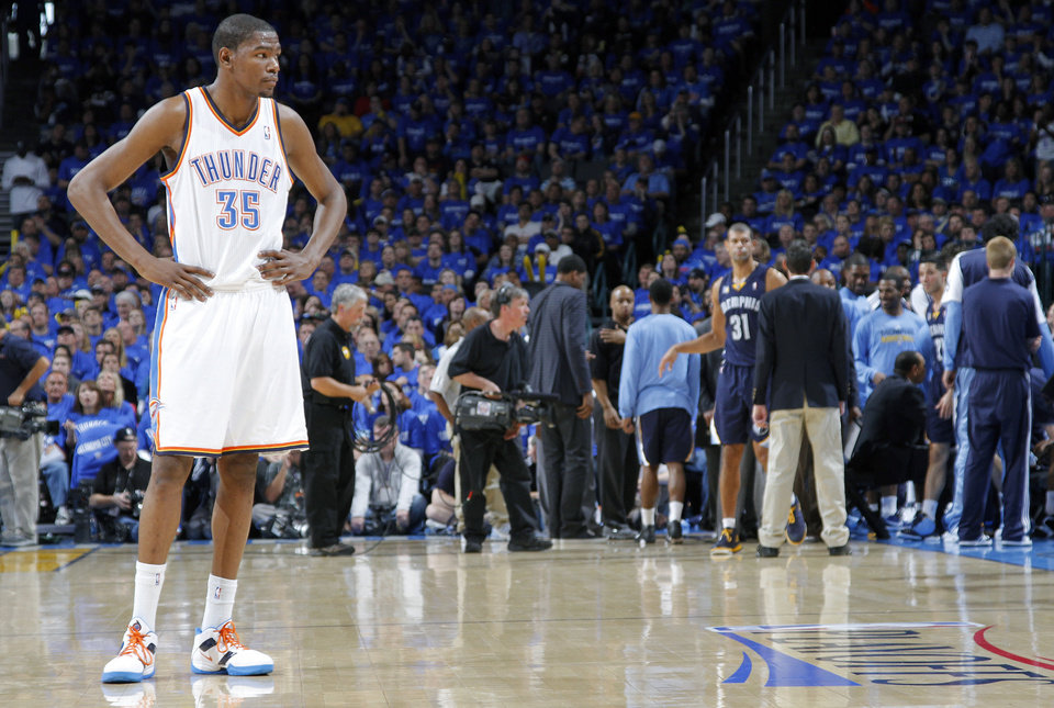 Photo - Oklahoma City's Kevin Durant looks to the sideline during a time out late in the 114-101 loss to Memphis during game one of the Western Conference semifinals between the Memphis Grizzlies and the Oklahoma City Thunder in the NBA basketball playoffs at Oklahoma City Arena in Oklahoma City, Sunday, May 1, 2011. Photo by Chris Landsberger, The Oklahoman