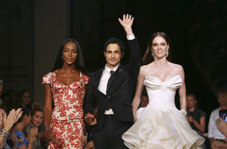 Photo -   Models Naomi Campbell, left, and Coco, right, walk with designer Zac Posen at the Zac Posen Spring 2013 Runway Show on Sunday, Sept. 9, 2012 in New York. (Photo by Amy Sussman/Invision/AP Images)
