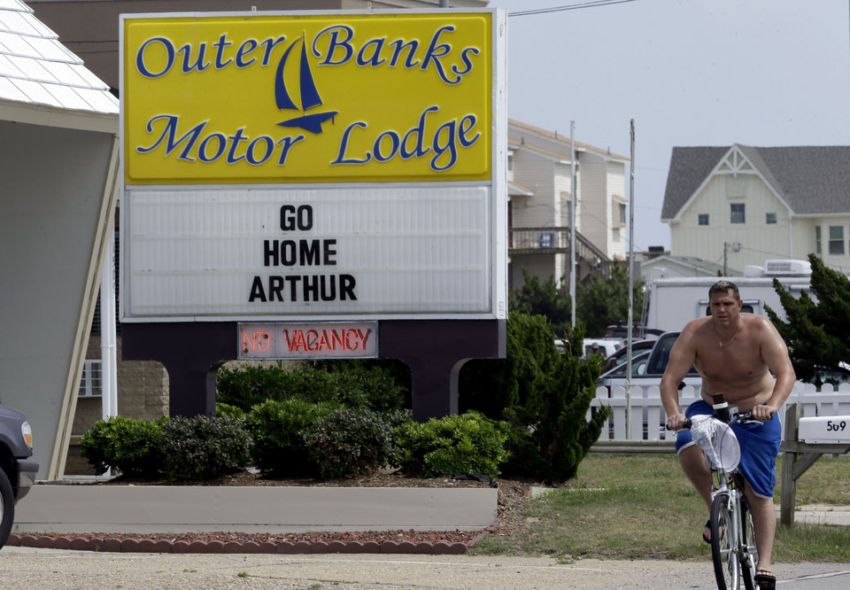 Photo - A sign at the Outer Banks Motor Lodge displays a message in Kill Devil Hills, N.C., Thursday, July 3, 2014. Hurricane Arthur is forecast to pass by Hatteras Island on Friday morning. The island is under mandatory evacuation orders. (AP Photo/Gerry Broome)