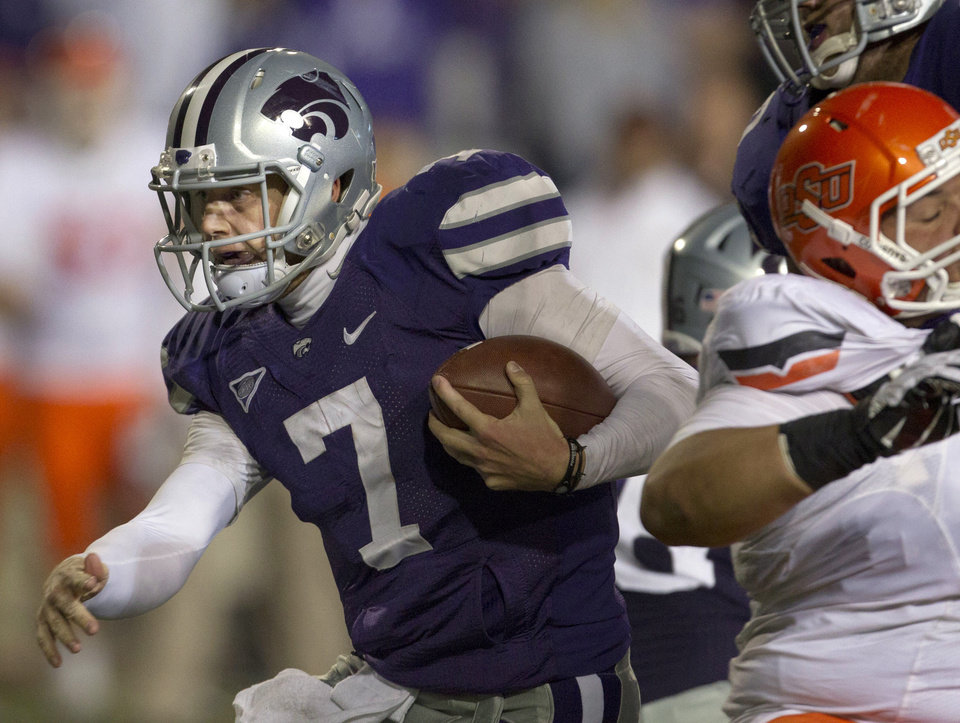 Kansas State quarterback Collin Klein (7) runs for a first down during the first half of an NCAA college football game against Oklahoma State in Manhattan, Kan., Saturday, Nov. 3, 2012. (AP Photo/Orlin Wagner)