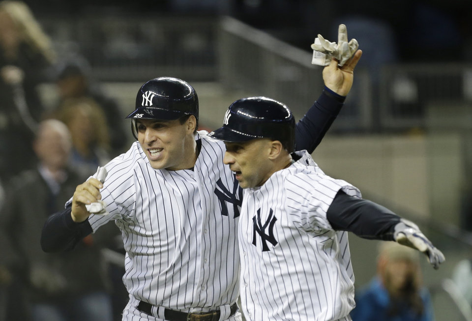 Photo -   New York Yankees' Mark Teixeira, left, and teammate Raul Ibanez celebrate after Ibanez hit a two-run home run in the ninth inning of Game 1 of the American League championship series against the Detroit Tigers Saturday, Oct. 13, 2012, in New York. (AP Photo/Paul Sancya )