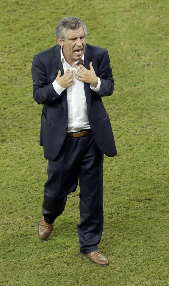 Photo - Greece's head coach Fernando Santos leaves the pitch after he was sent off during the World Cup round of 16 soccer match between Costa Rica and Greece at the Arena Pernambuco in Recife, Brazil, Sunday, June 29, 2014. (AP Photo/Hassan Ammar)