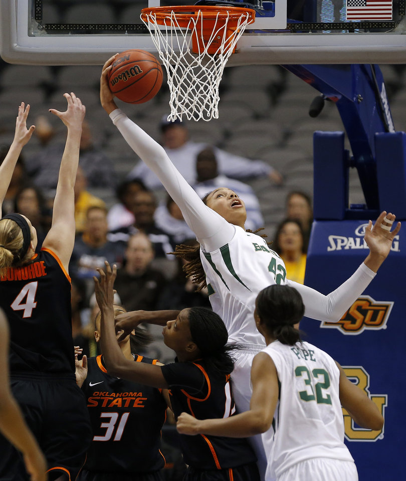 Baylor\'s Brittney Griner (42) grabs a rebound over Oklahoma State\'s Liz Donohoe (4), Kendra Suttles (31), and Toni Young (15) during the Big 12 tournament women\'s college basketball game between Oklahoma State University and Baylor at American Airlines Arena in Dallas, Sunday, March 10, 2012. Photo by Bryan Terry, The Oklahoman