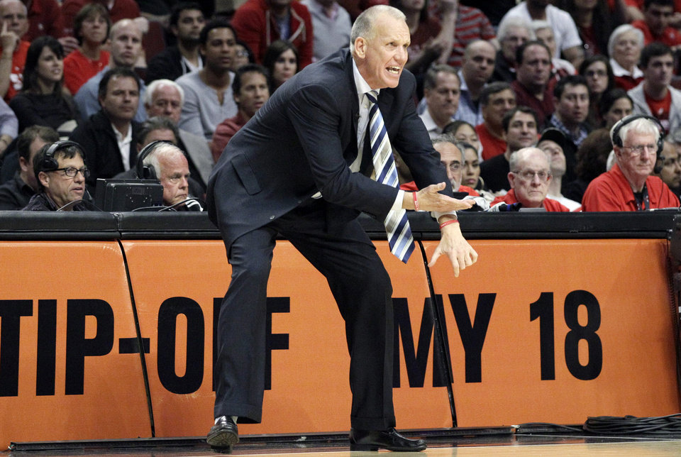 Photo -   Philadelphia 76ers head coach Doug Collins yells his team during the third quarter of Game 5 in an NBA basketball first-round playoff series against the Chicago Bulls in Chicago on Tuesday, May 8, 2012. The Bulls won 77-69. (AP Photo/Nam Y. Huh)