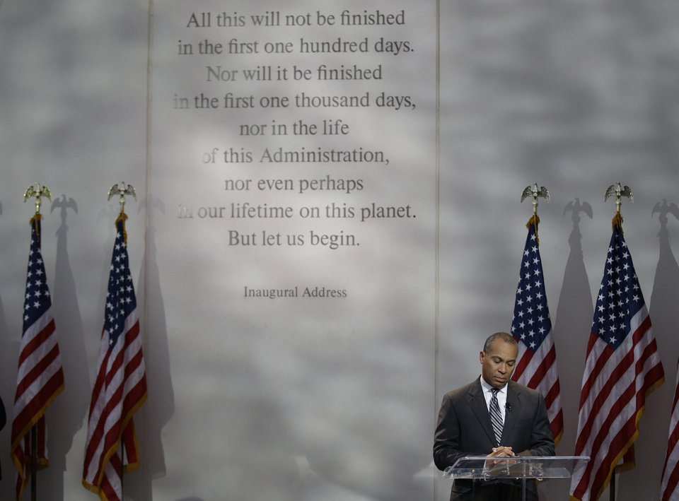 Photo - Massachusetts Gov. Deval Patrick calls for a moment of silence at 1:58 PM EST to mark the time of death for President Kennedy during a ceremony to commemorate the 50th anniversary of Kennedy's assassination at the John F. Kennedy Library and Museum in Boston, on Friday, Nov. 22, 2013. Kennedy, the 35th President of the United State, was assassinated in Dallas, Texas 50 years ago today. (AP Photo/Stephan Savoia)