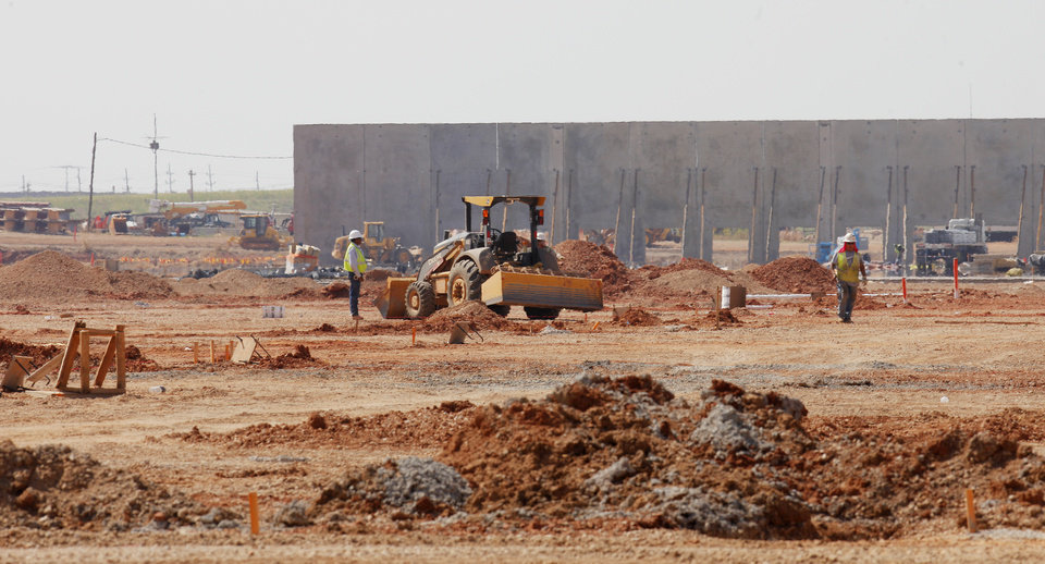 Photo -  Large concrete slabs, each weighing several tons, are being hoisted to form the walls of the new Hobby Lobby warehouse at 6900 SW 29 in Oklahoma City. Photo by Paul B. Southerland, The Oklahoman   PAUL B. SOUTHERLAND -
