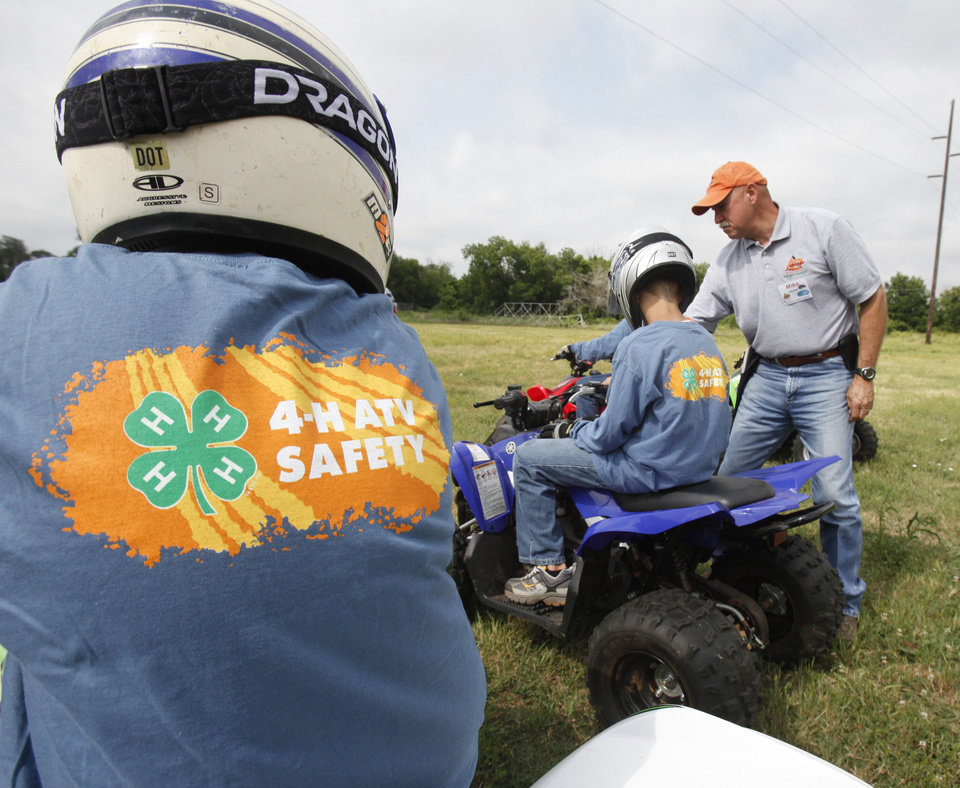 Photo - Instructor Mike Klumpp works with riders during a children's ATV safety course at the Logan County Fairgounds in Guthrie, OK, Friday, May 25, 2012,  By Paul Hellstern, The Oklahoman