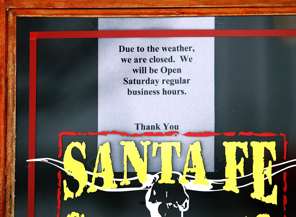 Photo - Many businesses either closed or  opened for reduced hours during this week's winter storm. This sign was taped to the front door of the Santa Fe Cattle Co. restaurant on SE 29 in Midwest City, Friday afternoon, Jan. 29, 2010. Photo by Jim Beckel, The Oklahoman