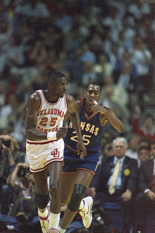 Danny Manning, right, gestures to Oklahoma\'s Harvey Grant after Manning led a basket despite Grant\'s defensive attempt during the championship game of the final four tournament in Kansas City on Monday, April 5, 1988. (AP Photo/John Gaps) John Gaps - ASSOCIATED PRESS