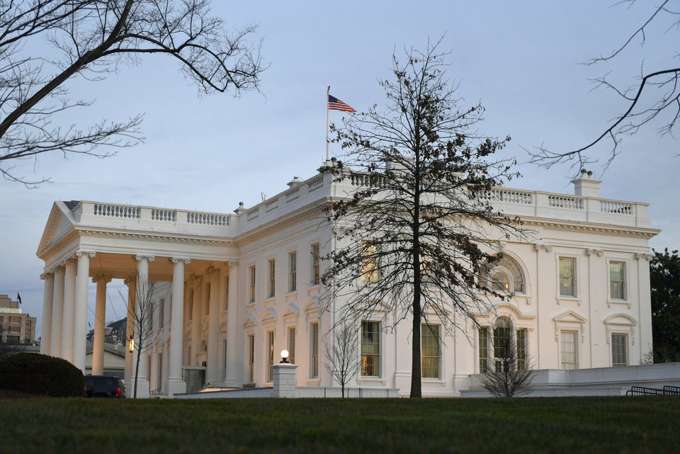 Photo - The sun sets on the White House in Washington, Thursday, Jan. 19, 2017, on President Barack Obama's final full day as President. (AP Photo/Susan Walsh)