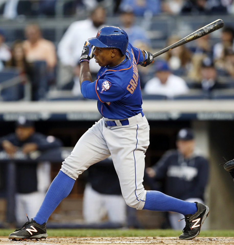 Photo - New York Mets Curtis Granderson hits a first-inning, three-run home run in a baseball game against the New York Yankees at Yankee Stadium in New York, Tuesday, May 13, 2014. (AP Photo)