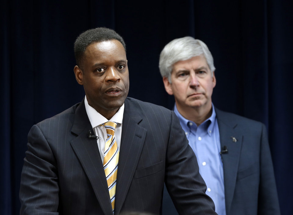 Kevyn Orr, left, speaks as as Michigan  Gov. Rick Snyder listens during a news conference in Detroit, Thursday, March 14, 2013. Snyder announced Thursday that he had chosen Orr, a partner in the Cleveland-based law and restructuring Jones Day firm, as Detroit's emergency manager. Snyder's already declared a financial emergency in Detroit, saying local officials lacked a plan to solve it. (AP Photo/Paul Sancya)