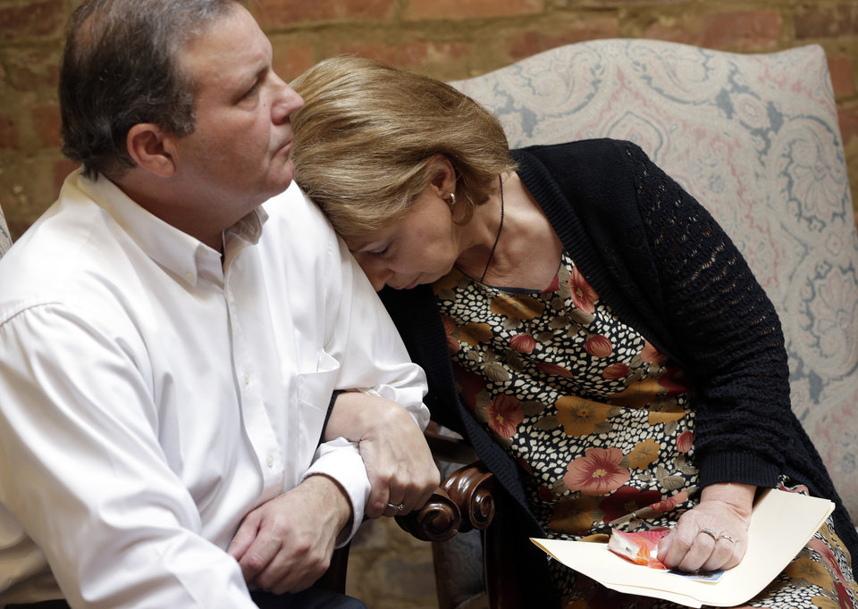 Photo -   CORRECTS NAME TO REED COLLAR, NOT KENT COLLAR - Bonnie Collar finds comfort in her husband Reed's shoulder as their attorney, Jere Beasley, describes the videotaped death of their son, University of South Alabama freshman Gil Collar, during a news conference Thursday, Oct. 11, 2012 in Montgomery, Ala. Collar was fatally shot by a campus police officer at the University of South Alabama on Oct. 6.