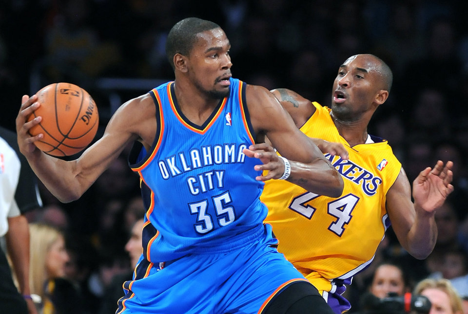 The Oklahoma City Thunder's Kevin Durant (35) works against the Los Angeles Lakers' Kobe Bryant at Staples Center in Los Angeles, California, on Friday, January 11, 2013. (Wally Skalij/Los Angeles Times/MCT) ORG XMIT: 1133596
