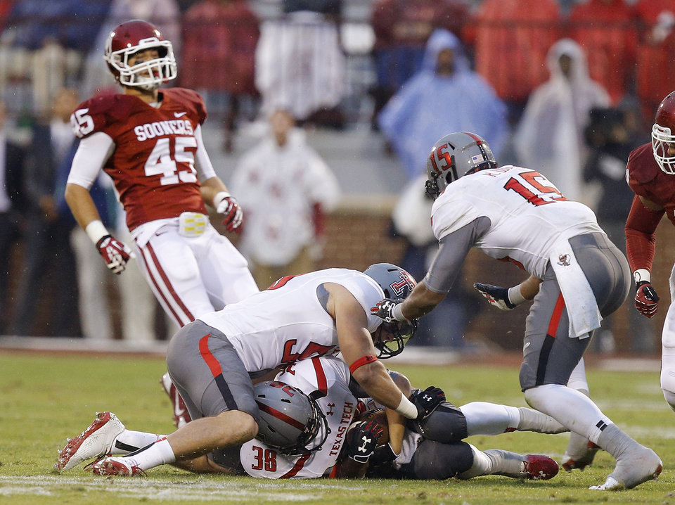 Texas Tech's Summitt Hogue (38) recovers an onside kick during a college football game between the University of Oklahoma Sooners (OU) and the Texas Tech Red Raiders at Gaylord Family-Oklahoma Memorial Stadium in Norman, Okla., on Saturday, Oct. 26, 2013. Oklahoma won 38-30. Photo by Bryan Terry, The Oklahoman