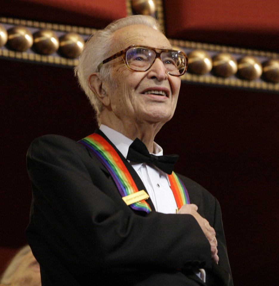 Photo - FILE - In this Dec. 6, 2009 file photo, Kennedy Center honoree Dave Brubeck stands for the National Anthem at the Kennedy Center Honors gala in Washington.  Brubeck, a pioneering jazz composer and pianist died Wednesday, Dec. 5, 2012 of heart failure, after being stricken while on his way to a cardiology appointment with his son. He would have turned 92 on Thursday.   (AP Photo/Alex Brandon, File)