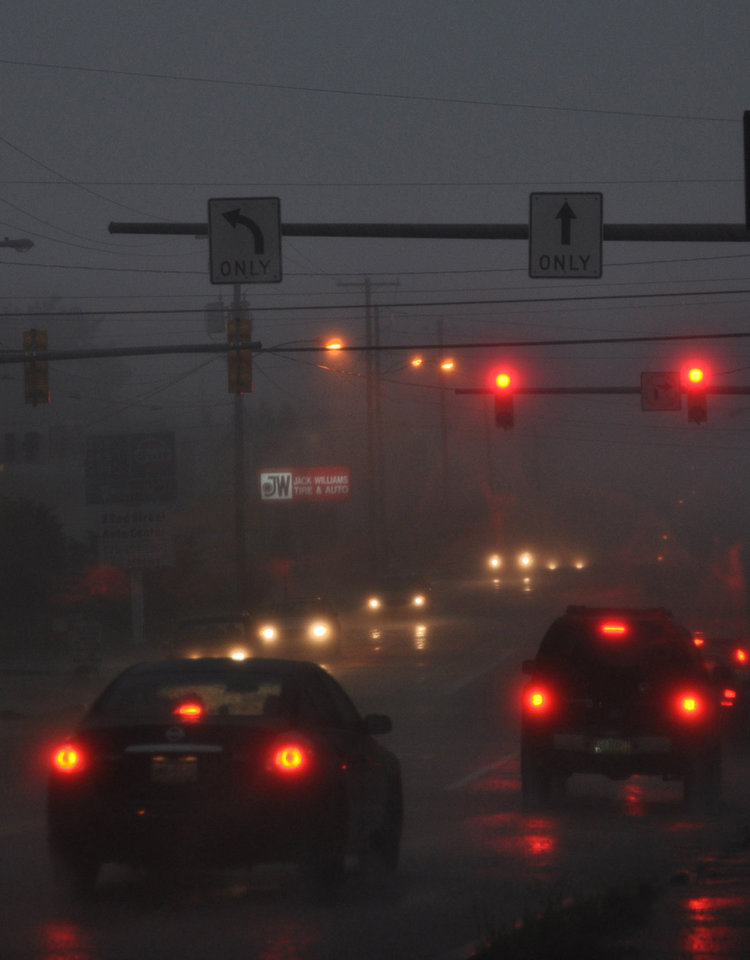 Photo -   Heavy rain falls as traffic moves along North Church Street in Hazleton, Pa. on Thursday, July 26, 2012. An outbreak of severe thunderstorms including widespread damaging winds are sweeping over parts of the Ohio Valley and the northeast. (AP Photo/Hazelton Standard-Speaker, Ellen F. O'Connell)