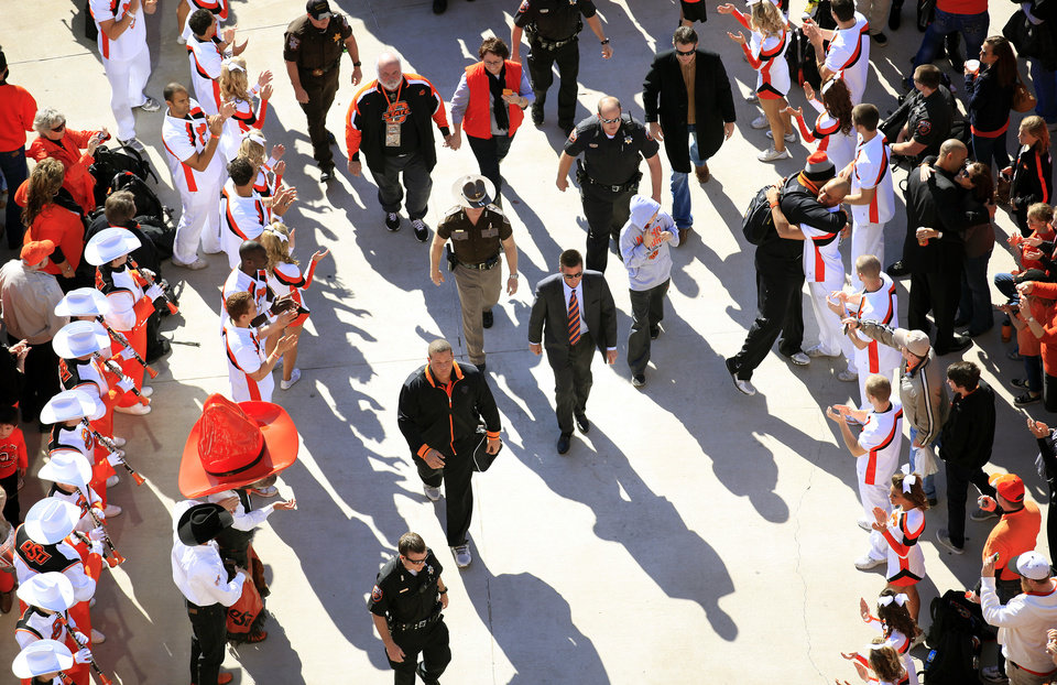 Oklahoma Sate head coach Mike Gundy arrive for the walk before a college football game between Oklahoma State University and the Texas Tech University (TTU) at Boone Pickens Stadium in Stillwater, Okla., Saturday, Nov. 17, 2012. Photo by Sarah Phipps, The Oklahoman