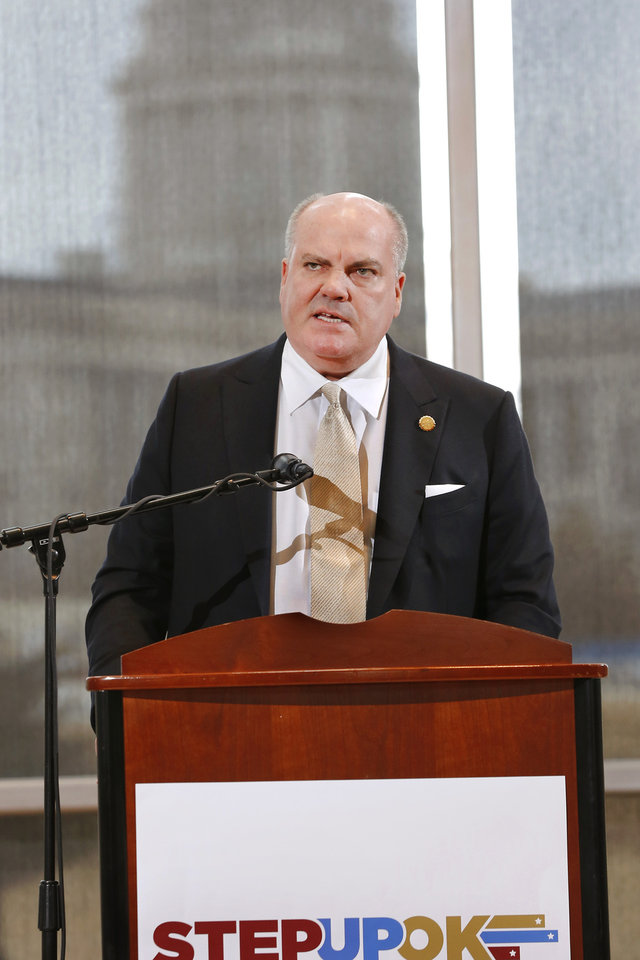 Photo - Phil Albert, president of Pelco Structural, and an OU regent, spoke in favor of the proposed reform and revenue measures at the news conference. Frustrated by a legislative budget impasse that has stalled state progress, a statewide coalition of Oklahoma business and civic leaders (STEPUPOK) proposed a comprehensive solution Thursday, Jan. 11, 2018,  that would increase state revenues, fund $5,000 teacher pay raises and alter the structure of state and county government.  The proposal calls for raising gross production, motor fuel and cigarette taxes, while eliminating certain individual income tax deductions and loopholes.  The business leaders said their willingness to support the proposed revenue hikes is directly tied to lawmakers' willingness to vote for $5,000 teacher pay increases and embrace 10 reforms to the structure of state and county government, many of which also would require the public's approval through votes on constitutional amendments.  Photo by Jim Beckel, The Oklahoman