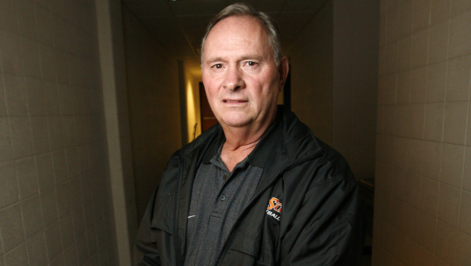 Photo - New OSU college football defensive coordinator Bill Young poses for a photograph in a hall at Gallagher-Iba Arena on the campus of Oklahoma State University in Stillwater, Okla., Friday, January 23, 2009. BY NATE BILLINGS, THE OKLAHOMAN ORG XMIT: KOD