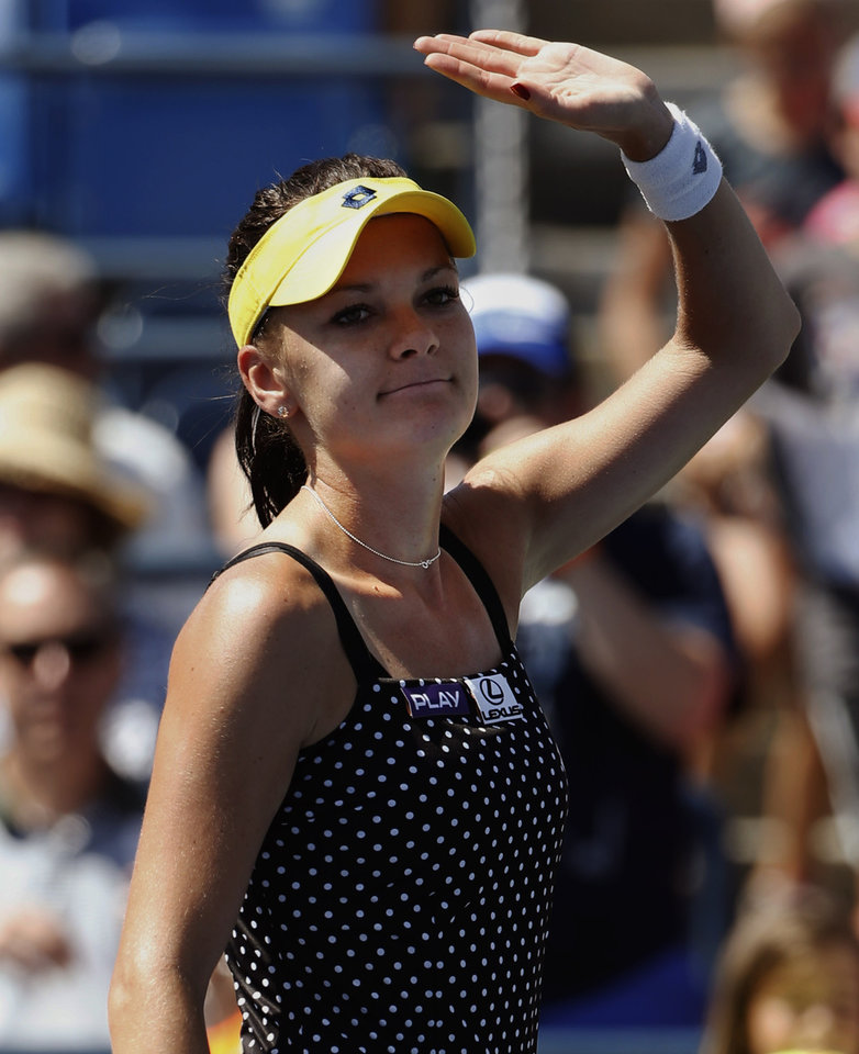 Photo - Agnieszka Radwanska, of Poland, waves to tennis fans after defeating Sharon Fichman, of Canada, during the opening round of the 2014 U.S. Open tennis tournament, Monday, Aug. 25, 2014, in New York. (AP Photo/Kathy Willens)