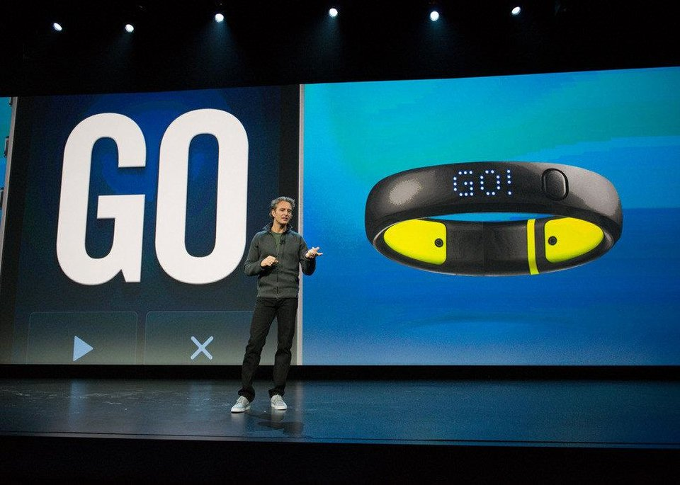 Photo - Stefan Olander, Nike's vice president of Digital Sport, presents information about the Nike FuelBand_SE at the NikeFuel Forum event in October. PHOTO PROVIDED.