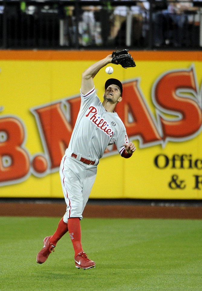 Photo - Philadelphia Phillies left fielder Grady Sizemore misses New York Mets' Juan Lagares's fly ball, allowing two runs to score, in the seventh inning of a baseball game at Citi Field, Friday, Aug. 29, 2014, in New York. Sizemore received an error on the play. (AP Photo/Kathy Kmonicek)