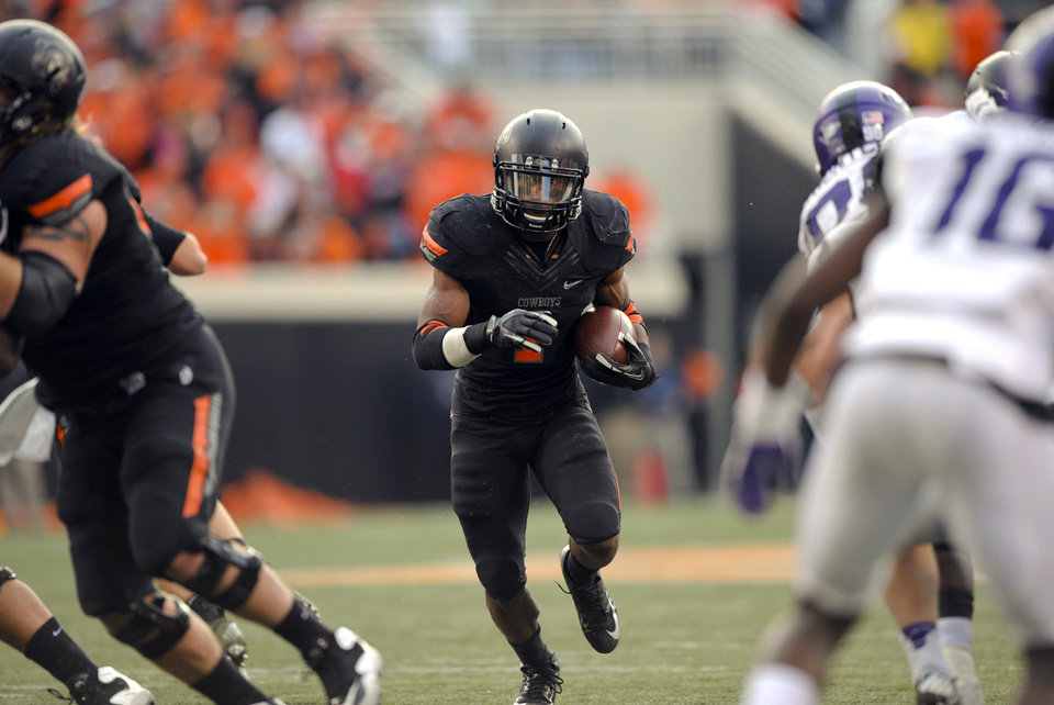 Photo -   Oklahoma State running back Joseph Randle, center, finds an opening in TCU's defense during the second half of an NCAA college football game in Stillwater, Okla., Saturday, Oct. 27, 2012. Randle had 126 yards rushing and a touchdown in the 36-14 win over TCU. (AP Photo/Brody Schmidt)