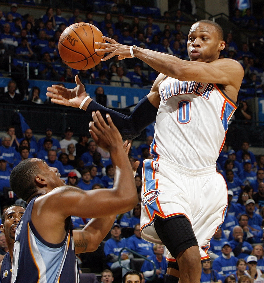 Oklahoma City's Russell Westbrook (0) passes the ball away from Darrell Arthur (00) of Memphis in the first half during game one of the Western Conference semifinals between the Memphis Grizzlies and the Oklahoma City Thunder in the NBA basketball playoffs at Oklahoma City Arena in Oklahoma City, Sunday, May 1, 2011. Photo by Nate Billings, The Oklahoman