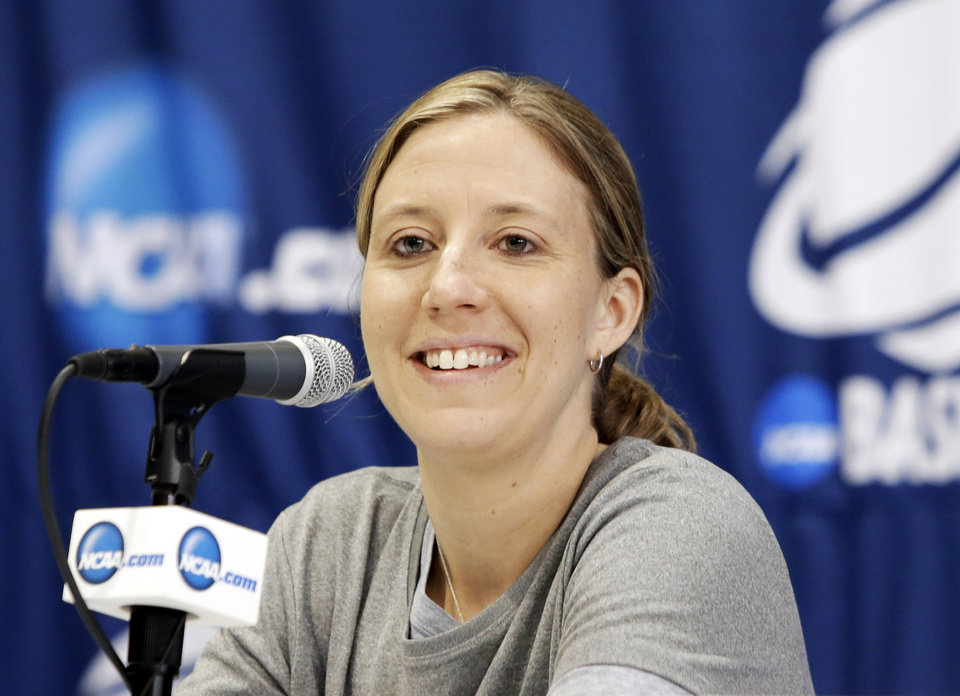 Photo - California head coach Lindsay Gottlieb responds to questions during an NCAA college basketball tournament news conference, Sunday, March 23, 2014, in Waco, Texas. California is scheduled to play Baylor on Monday. (AP Photo/Tony Gutierrez)