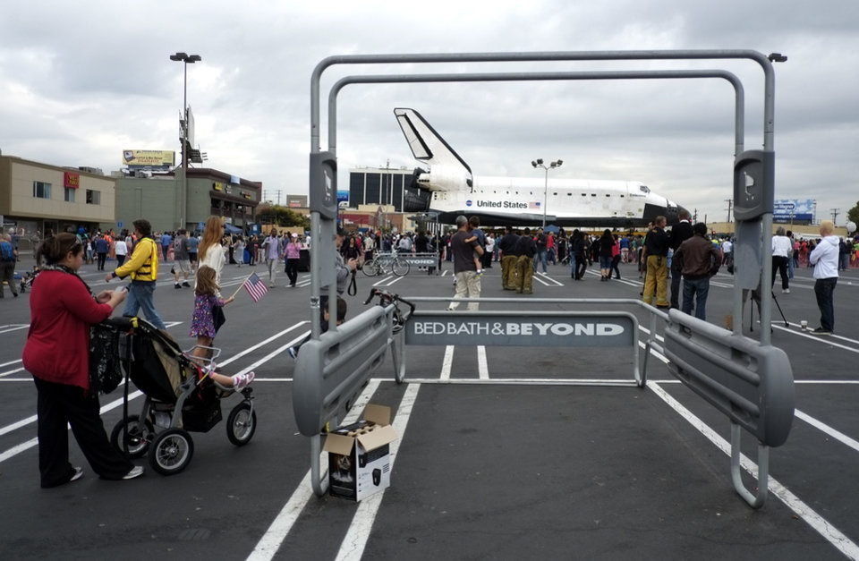 The space shuttle Endeavour sits in a strip mall in Los Angeles, Friday, Oct. 12, 2012. Endeavour\'s two-day, 12-mile (19 kilometer) road trip to the California Science Center where it will be put on display kicked off around midnight Friday. Rolled on a 160-wheeled carrier, it left from a hangar at the Los Angeles International Airport, passing diamond-shaped