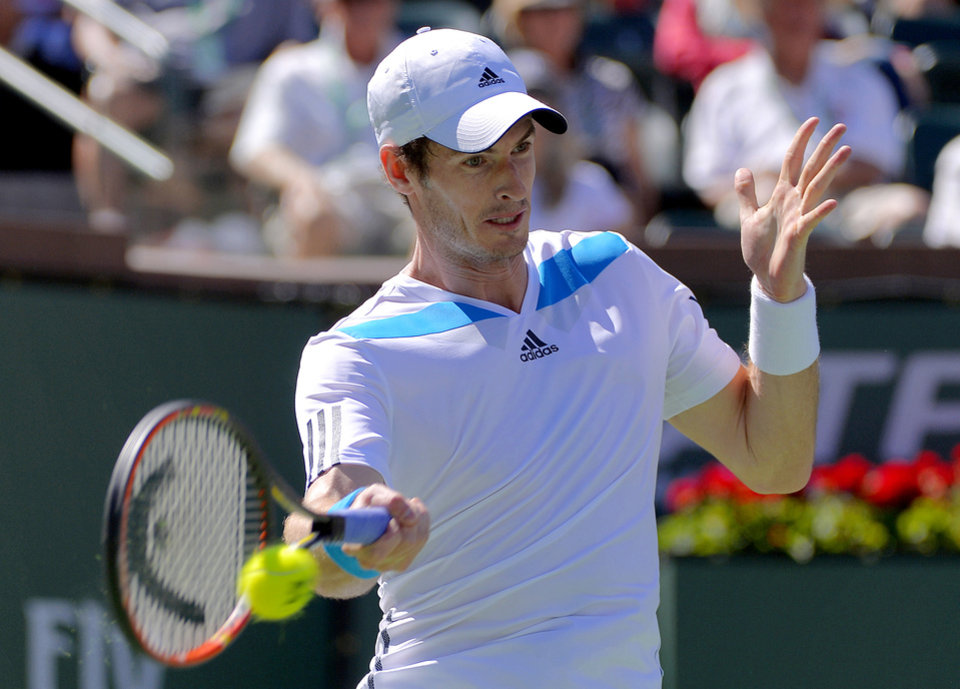 Photo - Andy Murray, of Great Britain, returns a hit by Jiri Vesely, of Czech Republic, during a third round match at the BNP Paribas Open tennis tournament, Monday, March 10, 2014, in Indian Wells, Calif. (AP Photo/Mark J. Terrill)