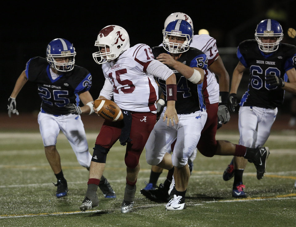 Photo - Ardmore's Clay Atwood (15) runs the ball during a high school football game between Deer Creek and Ardmore at Deer Creek Stadium in Edmond, Okla., Friday, Nov. 9, 2012.  Photo by Garett Fisbeck, The Oklahoman
