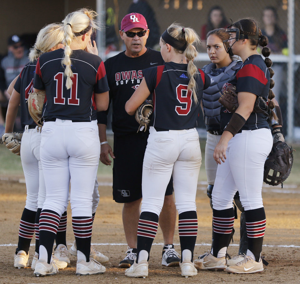 Photo - OHS coach Shane Eicher talks to the infielders during the 6A Fast Pitch Championship game between Edmond Memorial and Owasso at the Ball Fields at Firelake in Shawnee, Saturday, October 19, 2019. [Doug Hoke/The Oklahoman]