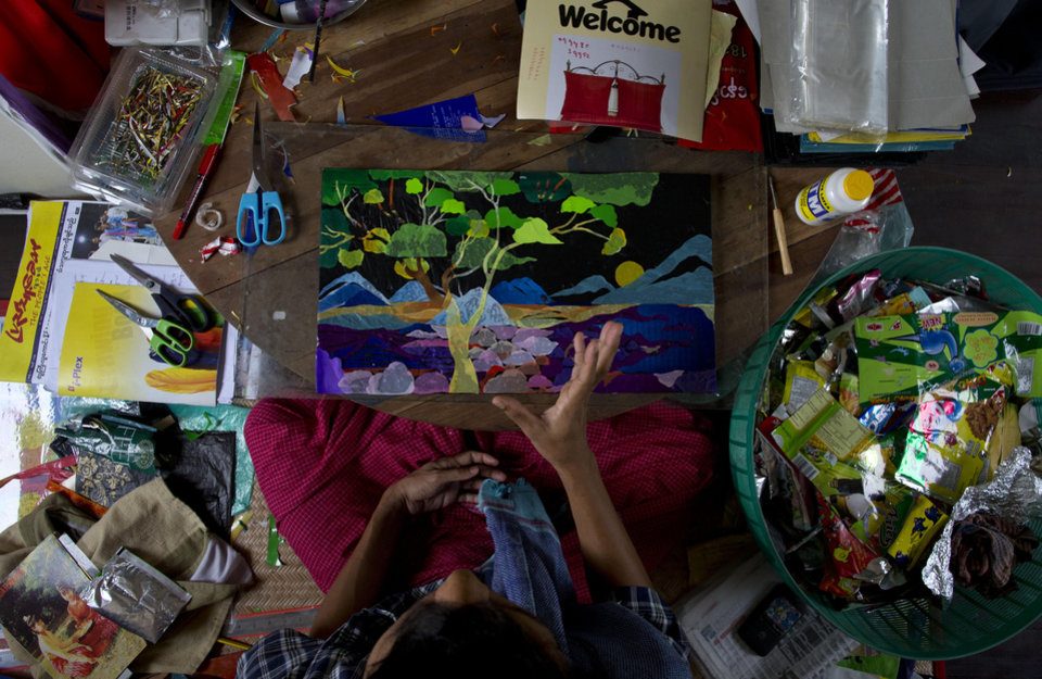 In this March 25, 2013 photo, San Zaw Htwe gestures as he sits in his art studio in Yangon, Myanmar. The former political prisoner will turn 39 on Saturday, March 30, the second anniversary of the day President Thein Sein took office and pledged to transform Myanmar from a military dictatorship to a free-market democracy. Thein Sein's administration has made remarkable progress toward that goal, but at a price that San Zaw Htwe knows only too well: forgetting the past. (AP Photo/Gemunu Amarasinghe)