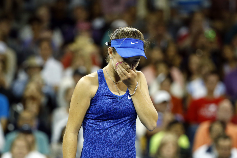 Photo - CiCi Bellis, of the United States, reacts after losing a point to Zarina Diyas, of Kazakhstan, during the second round of the U.S. Open tennis tournament Thursday, Aug. 28, 2014, in New York. (AP Photo/Jason DeCrow)