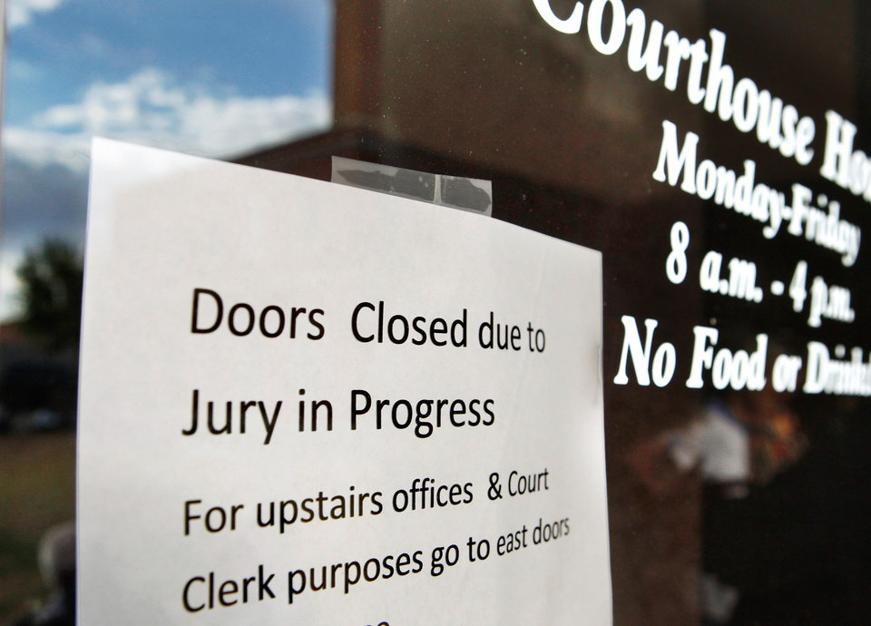 A sign taped to the east doors of the Greer County Courthouse. Much of the first floor of the building has been closed to visitors because the judge does not want jurors to be disturbed or distracted while they deliberate the fate of Bobbi Parker. The first full day of jury deliberations began Tuesday,  Sep. 20, 2011. after closing arguments were completed in the trial of Bobbi Parker late Monday night.  The trial is in the Greer County Courthouse in Mangum, Okla.  Photo by Jim Beckel, The Oklahoman