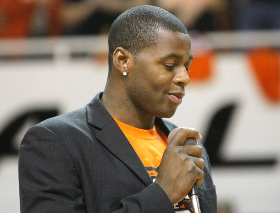 Photo - Desmond Mason speaks during a halftime ceremony honoring the 10 men killed in the 2001 plane crash at the basketball game between Oklahoma State and Texas, Wednesday, Jan. 26, 2011, at Gallagher-Iba Arena in Stillwater, Okla. Photo by Sarah Phipps, The Oklahoman
